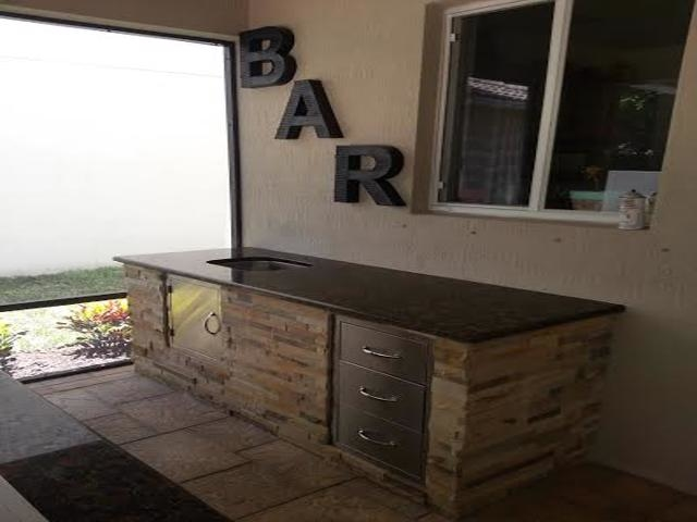 custom outdoor kitchen and bar