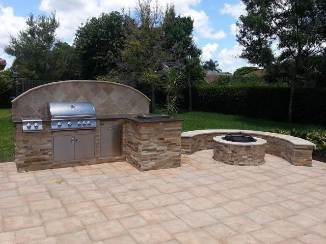 custom outdoor kitchen with BBQ and firepit